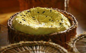 Sicilian cheese in wicker basket