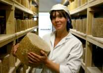 woman cheese maker holding cheese