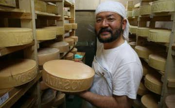 Japanese Artisan Cheese Making man holding cheese