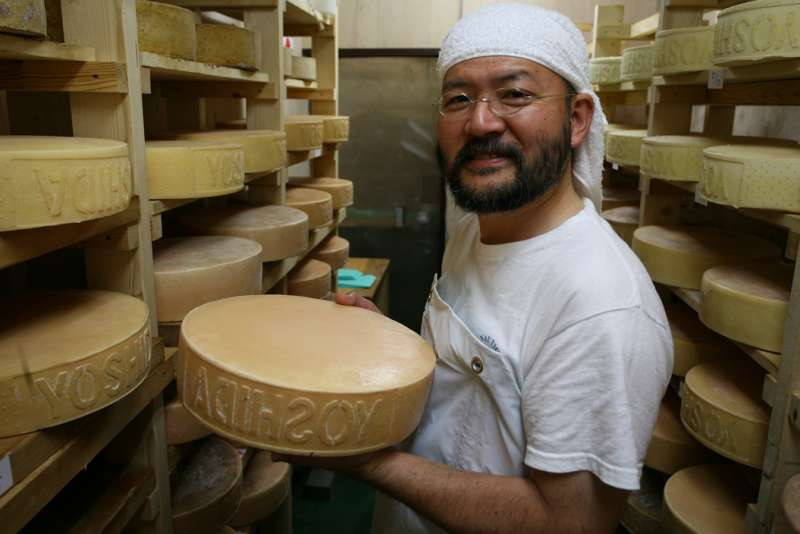 Japanese Artisan Cheese Making man holding cheese