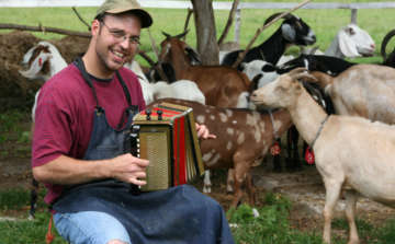 man singing with goats