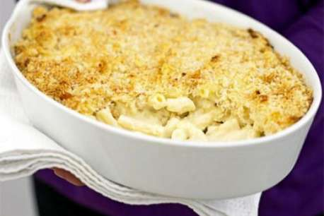 white bowl with Macaroni and cheese