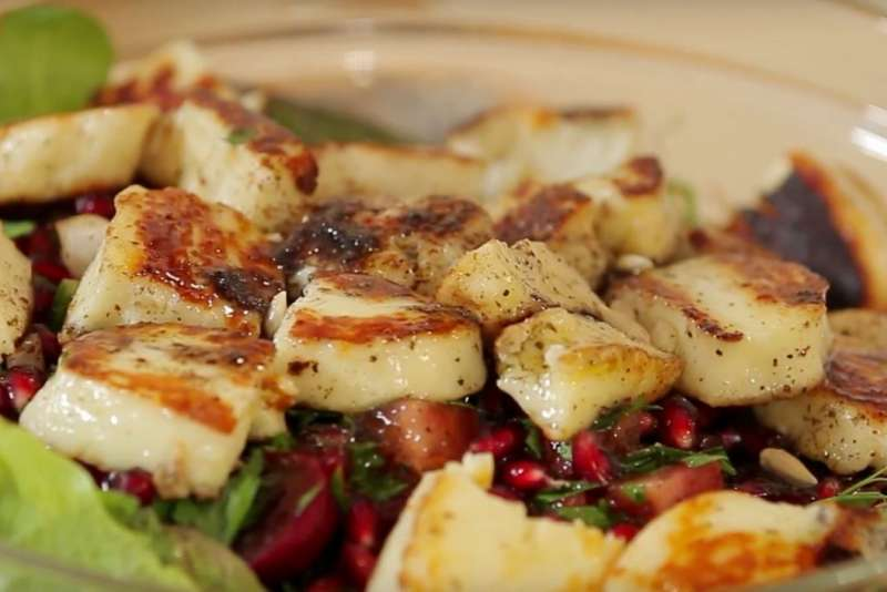 grilled halloumi on a salad