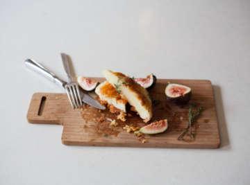 Artemis keflaotyri figs and honey on wood board