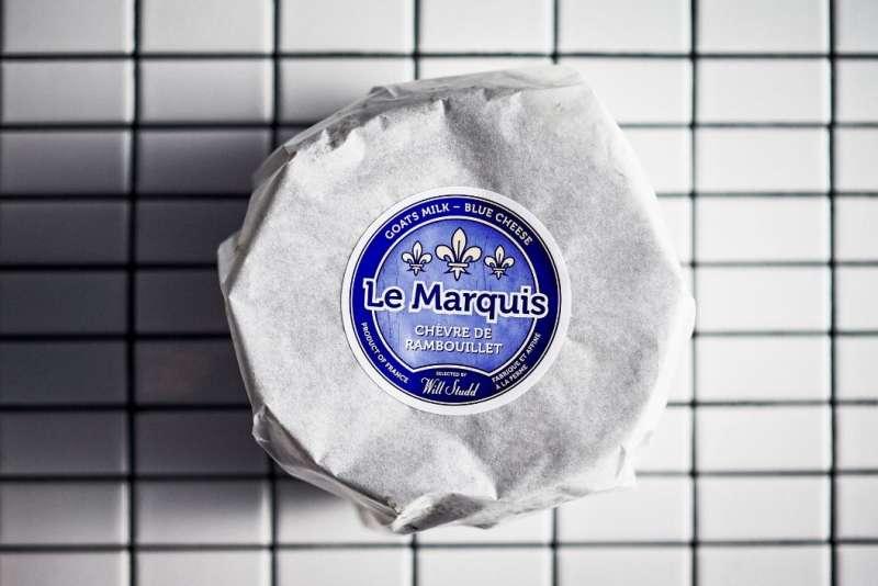 Le Marquis Chèvre de Rambouillet cheese on white tiles