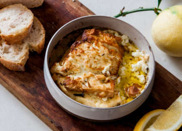 Aphrodite Marinated Feta Will Studd Baked in ceramic bowl