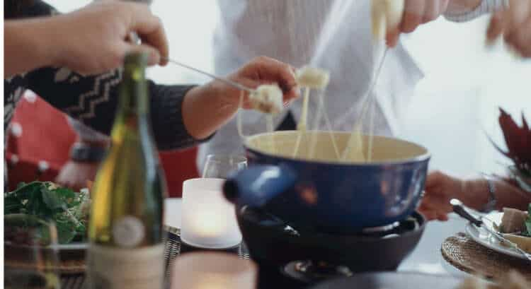 Cheese Fondue being dipped with bread