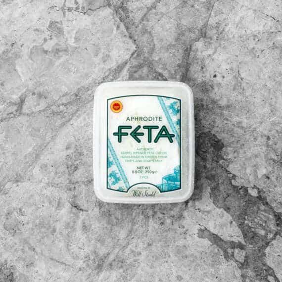 aphrodite barrel aged feta on grey tile
